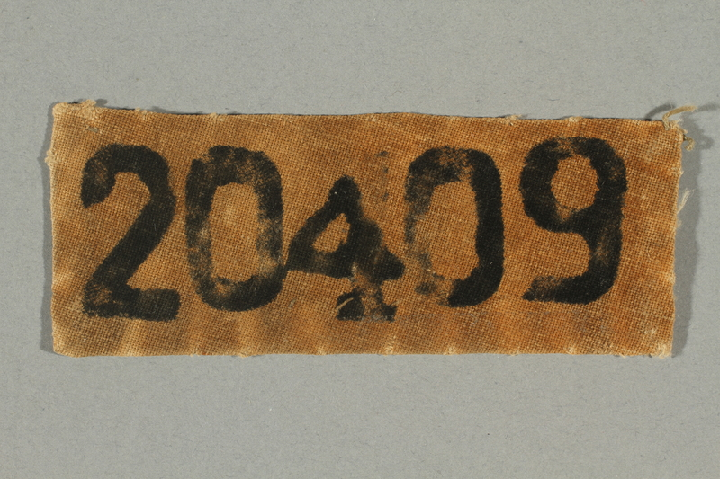 2017.645.2 front Numbered prisoner patch worn by a female Hungarian Jewish slave laborer