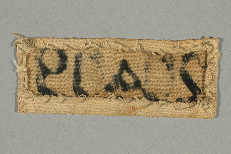 2017.645.2 back Numbered prisoner patch worn by a female Hungarian Jewish slave laborer