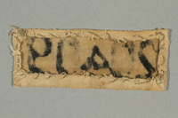 2017.645.2 back Numbered prisoner patch worn by a female Hungarian Jewish slave laborer  Click to enlarge