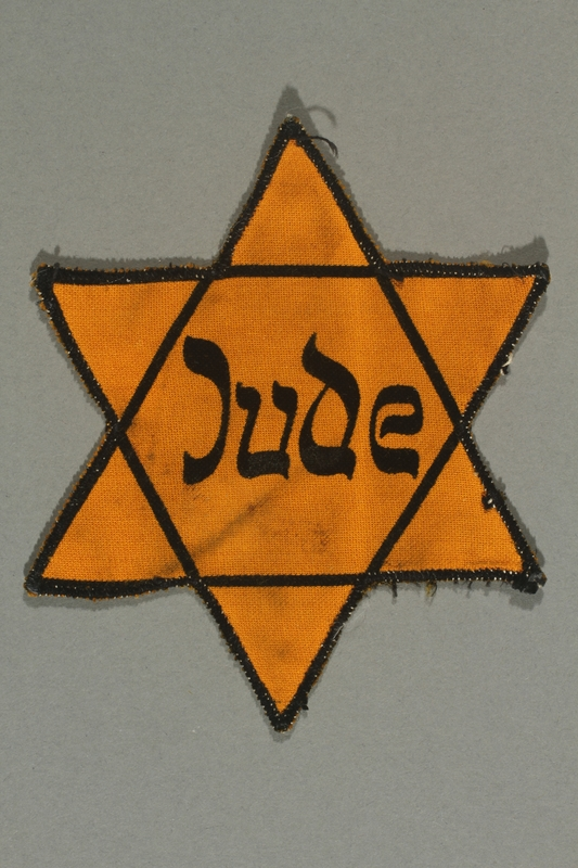 2018.70.4 front Star of David patch printed with Jude worn by a German Jewish woman