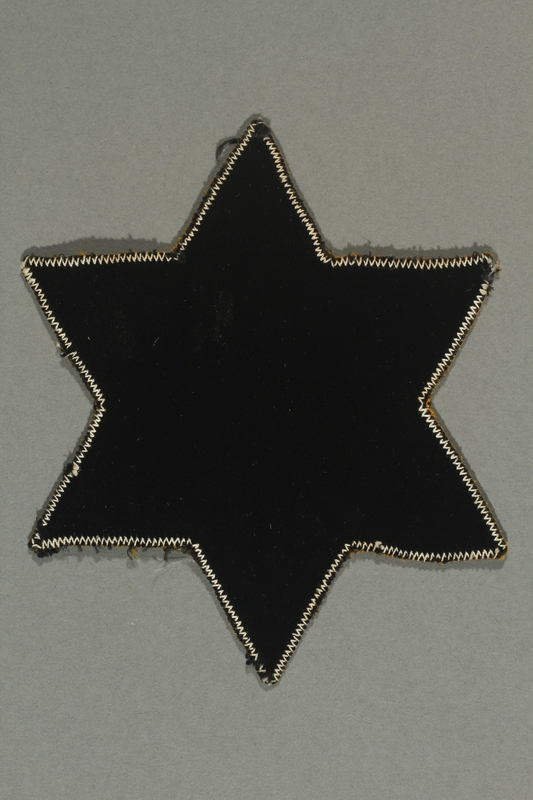 2018.70.4 back Star of David patch printed with Jude worn by a German Jewish woman