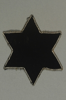 2018.70.4 back Star of David patch printed with Jude worn by a German Jewish woman  Click to enlarge