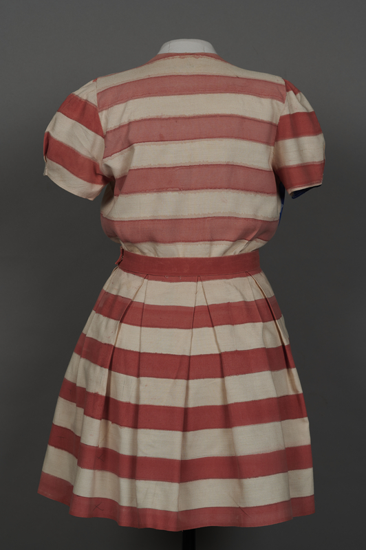 2018.70.2 back Stars and stripes dress worn by a German Jewish woman for a DP camp theatrical performance