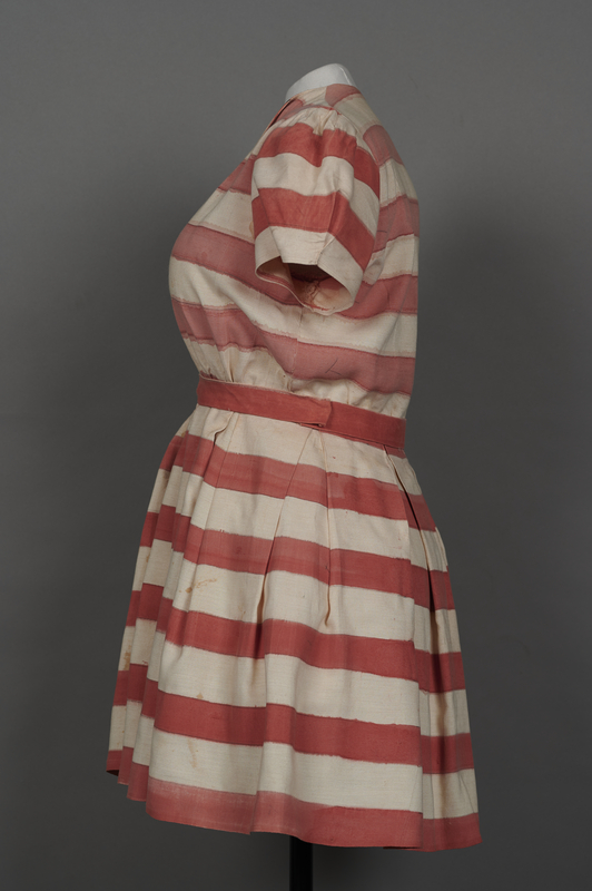 2018.70.2 left Stars and stripes dress worn by a German Jewish woman for a DP camp theatrical performance