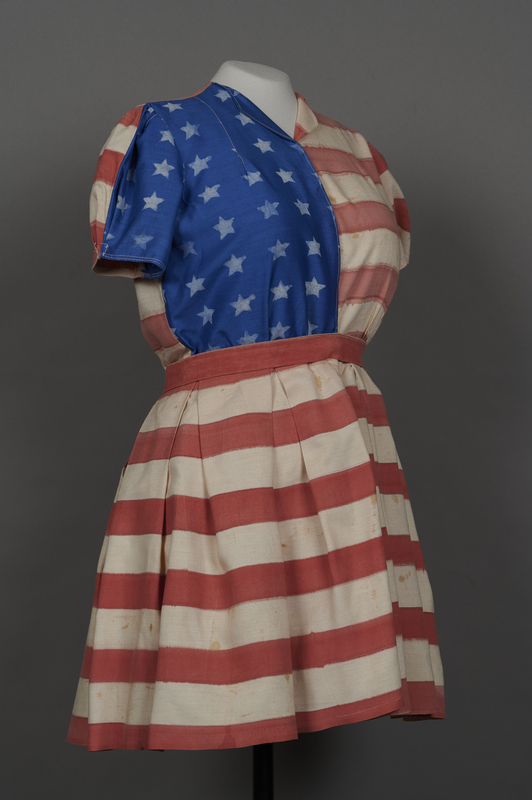 2018.70.2 3/4 right Stars and stripes dress worn by a German Jewish woman for a DP camp theatrical performance
