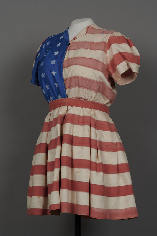 2018.70.2 3/4 left Stars and stripes dress worn by a German Jewish woman for a DP camp theatrical performance