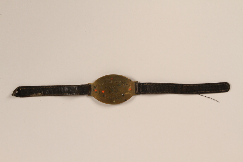 1992.160.8 front Identification bracelet