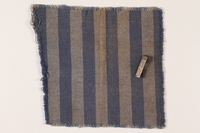 1992.161.1.1 front Identification pin attached to piece of concentration camp uniform  Click to enlarge