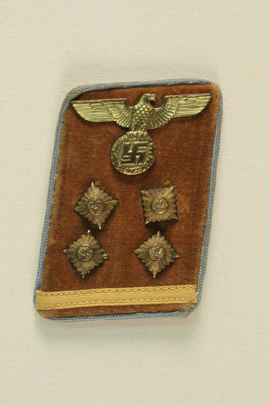 1992.163.1 front Military collar badge from jacket of German soldier