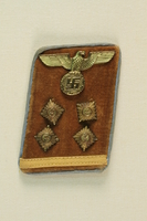 1992.163.1 front Military collar badge from jacket of German soldier  Click to enlarge