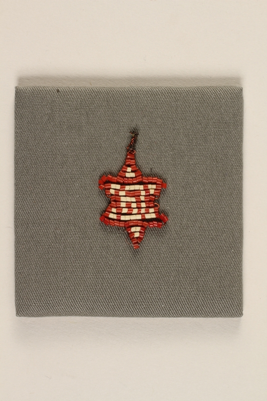 1992.164.1_b front Handmade Star of David pendant given to an American liberator by a Polish Jewish slave laborer