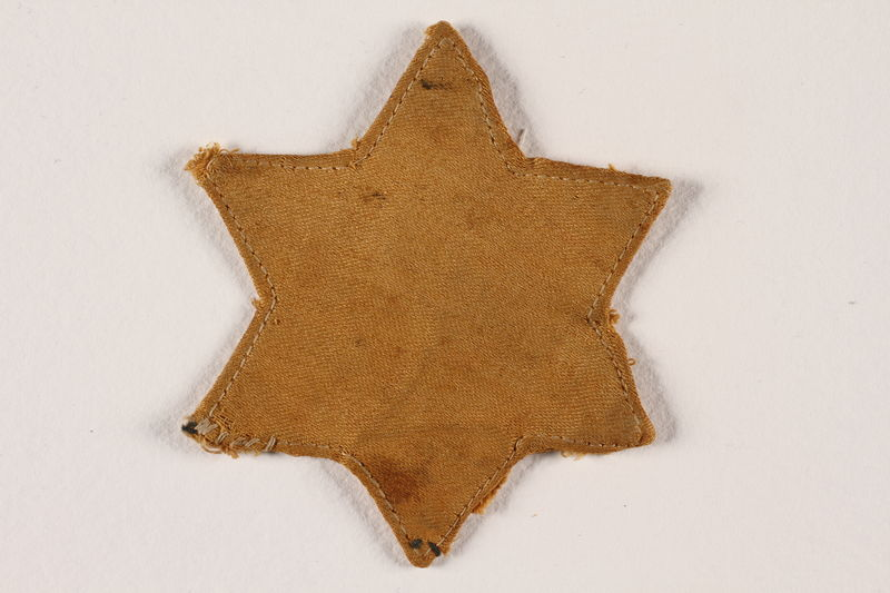 1992.169.1 front Star of David badge with a blank center worn in the Radun ghetto
