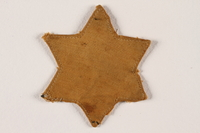 1992.169.1 front Star of David badge with a blank center worn in the Radun ghetto  Click to enlarge