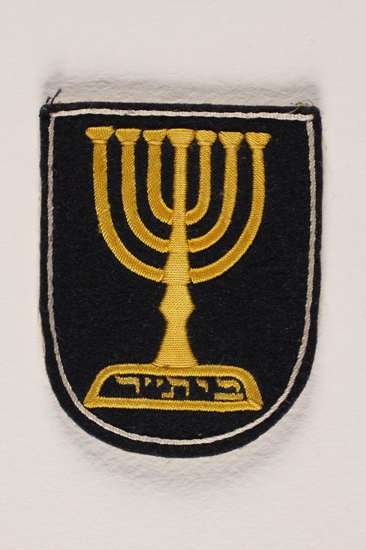 1992.169.11_a front Betar patch with an embroidered menorah worn by an internee at a displaced persons camp