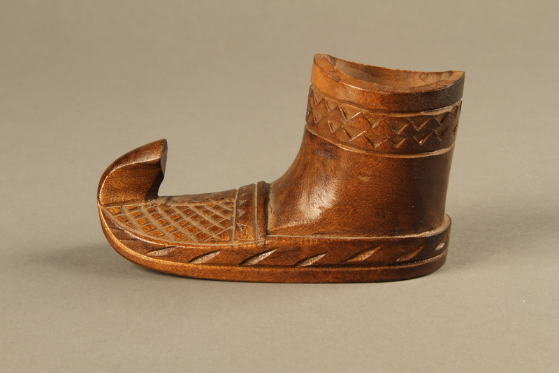 2017.609.3 left side Small handmade wooden boot owned by a Yugoslavian family
