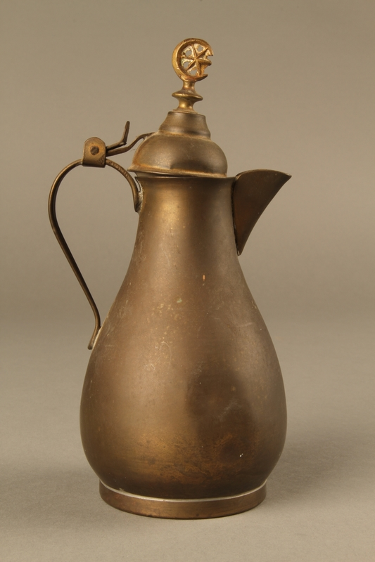 2017.609.5 right side Small metal coffeepot used by a Yugoslavian family
