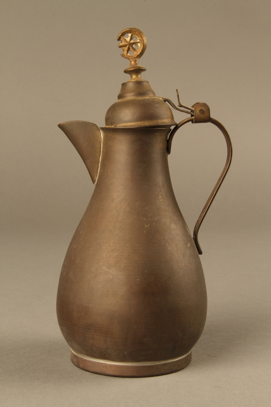 2017.609.5 left side Small metal coffeepot used by a Yugoslavian family