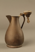 2017.609.5 3/4 view open Small metal coffeepot used by a Yugoslavian family  Click to enlarge