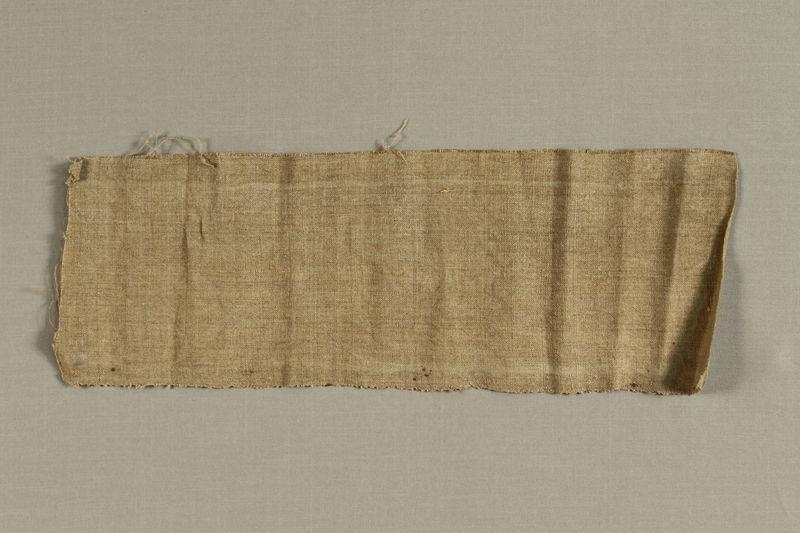 1992.169.13_a front Handmade linen band