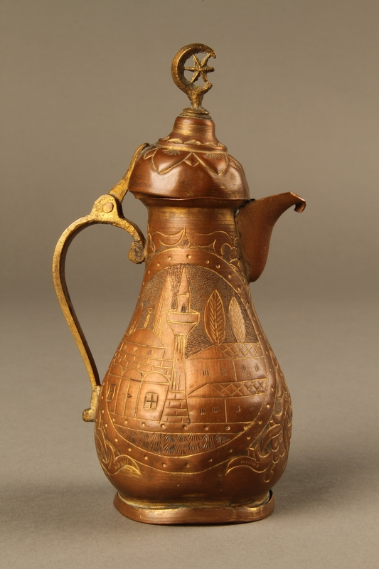 2017.609.8_a right side Small coffeepot and bowl with embossed designs used by a Yugoslavian family