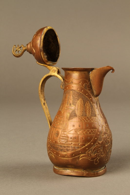 2017.609.8_a 3/4 view open Small coffeepot and bowl with embossed designs used by a Yugoslavian family