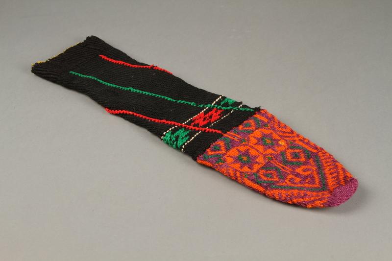 2017.609.9 a top Pair of wool mid-calf socks worn by a Yugoslavian man