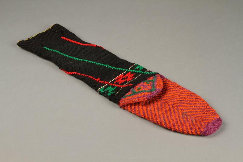 2017.609.9 a bottom Pair of wool mid-calf socks worn by a Yugoslavian man