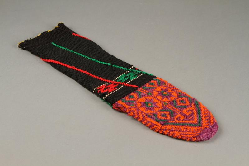 2017.609.9 b bottom Pair of wool mid-calf socks worn by a Yugoslavian man