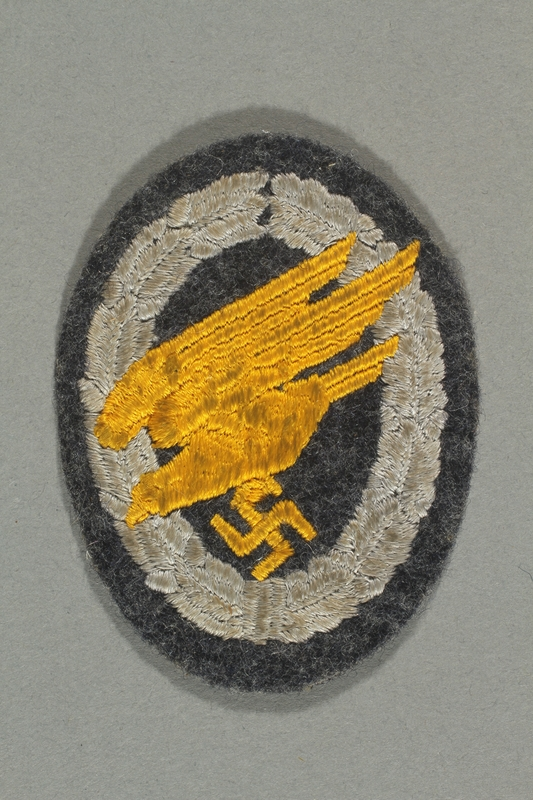 2012.478.7 front Luftwaffe paratrooper badge with a yellow eagle acquired by a German Jewish refugee in the British army