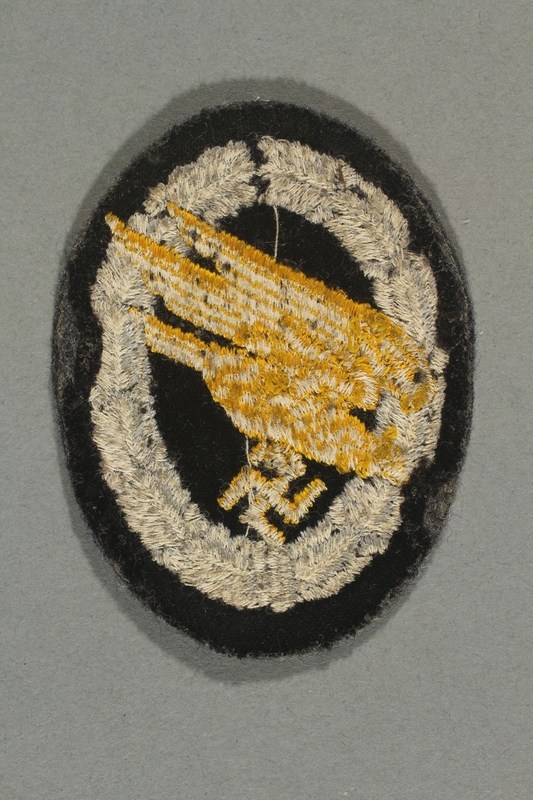 2012.478.7 back Luftwaffe paratrooper badge with a yellow eagle acquired by a German Jewish refugee in the British army