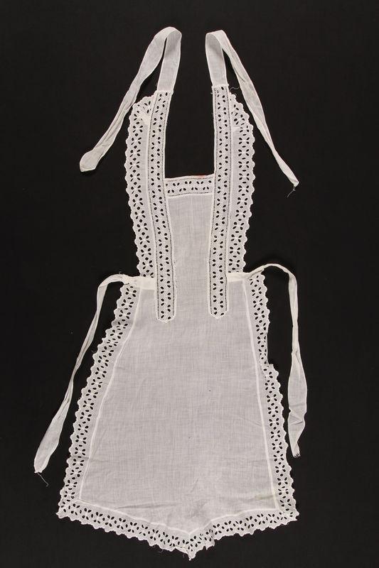 1992.169.15 front White apron used prewar in the Eisiskes shtetl