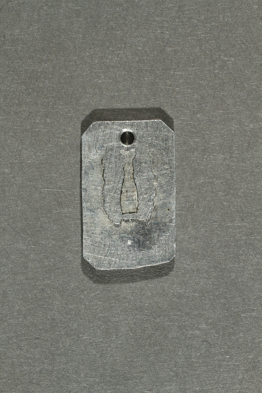 2018.70.7 back Commemorative concentration camp pendant owned by a German Jewish woman
