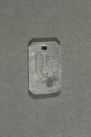 2018.70.7 back Commemorative concentration camp pendant owned by a German Jewish woman  Click to enlarge
