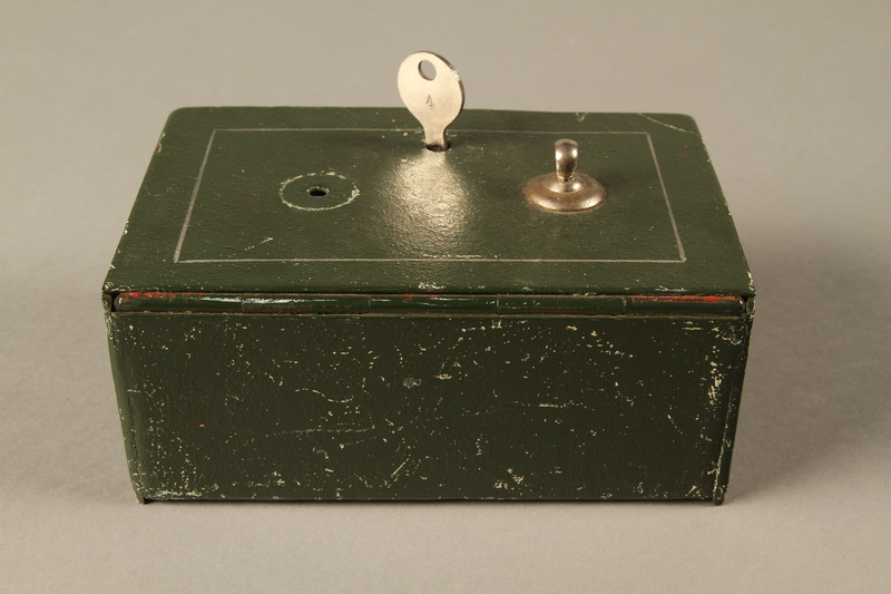 2018.133.3 a-c back Metal box with key