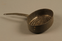 2018.426.11 side a Metal strainer used by an American internee  Click to enlarge