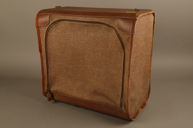 2018.426.2 3/4 view Brown cloth and leather trimmed suitcase used by an American internee