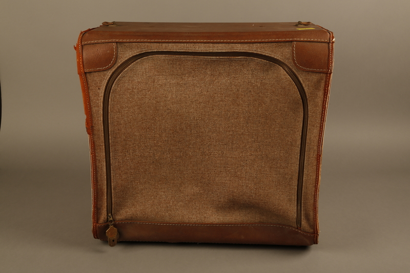 2018.426.2 front Brown cloth and leather trimmed suitcase used by an American internee