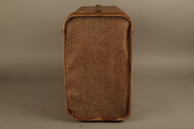 2018.426.2 left Brown cloth and leather trimmed suitcase used by an American internee