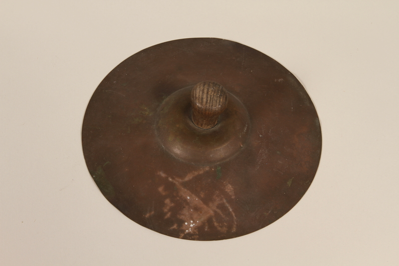 1992.169.24_a front Cymbals used by kindergartners prewar in the Eisiskes shtetl
