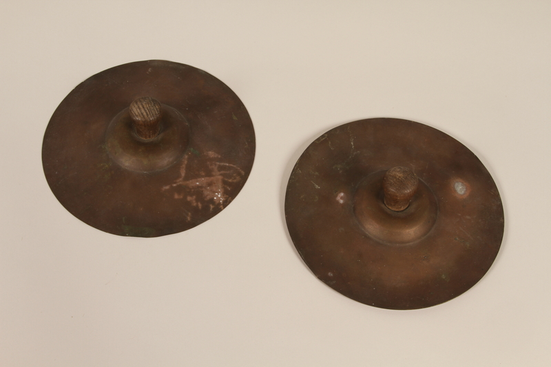 1992.169.24_a-b front Cymbals used by kindergartners prewar in the Eisiskes shtetl