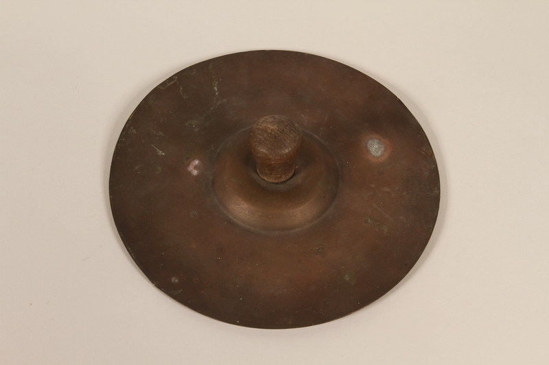 1992.169.24_b front Cymbals used by kindergartners prewar in the Eisiskes shtetl