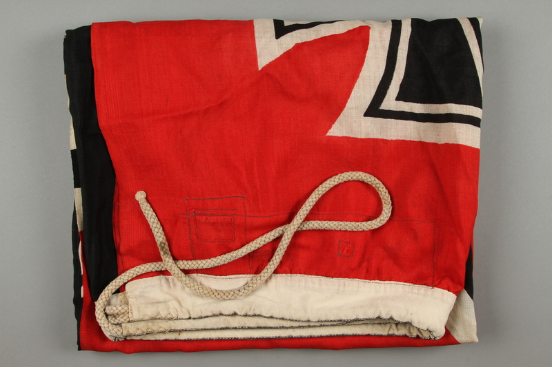 2018.230.2 side a Large red Nazi War ensign acquired by a US Army concentration camp liberator