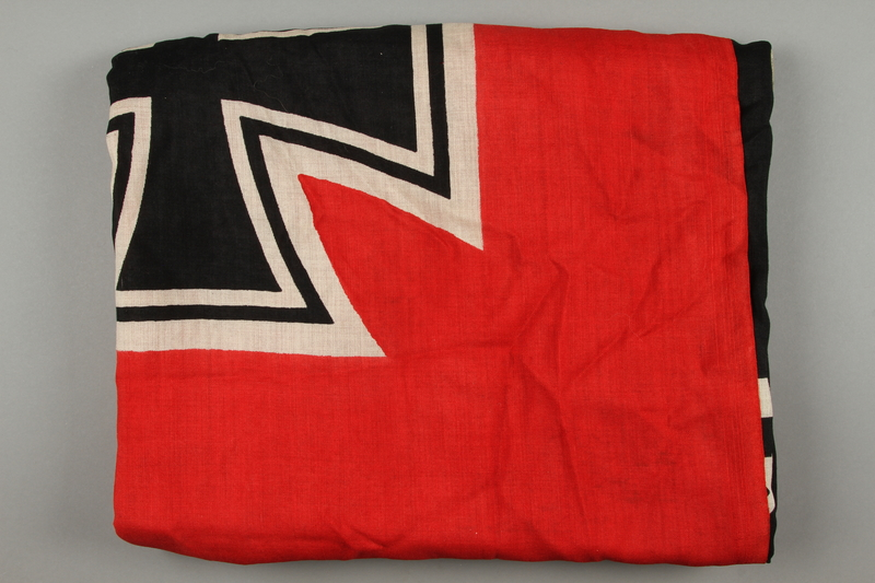 2018.230.2 side b Large red Nazi War ensign acquired by a US Army concentration camp liberator
