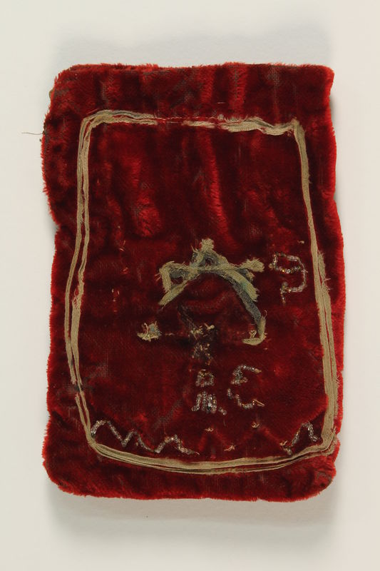 1992.169.3_a front Red brushed velvet tefillin pouch with a Star of David found in postwar Berlin