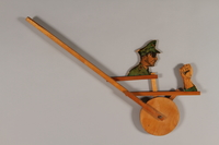2015.224.15 right Wooden wheel punching toy with Hitler as target  Click to enlarge