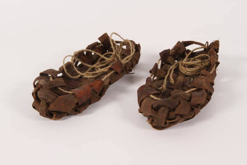 2015.457.1 a-b overall Replica of a pair of sandals like those worn by a Jewish Polish family in hiding