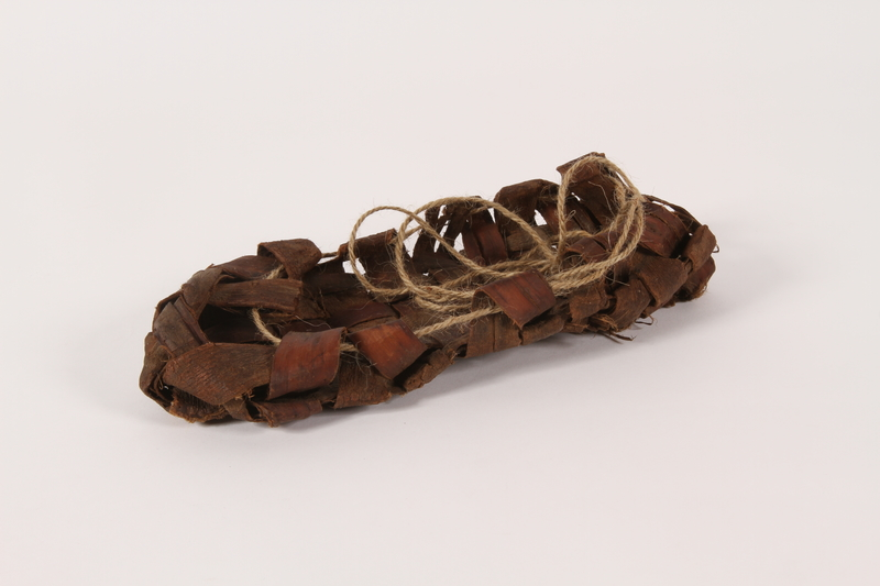2015.457.1 b 3/4 view Replica of a pair of sandals like those worn by a Jewish Polish family in hiding