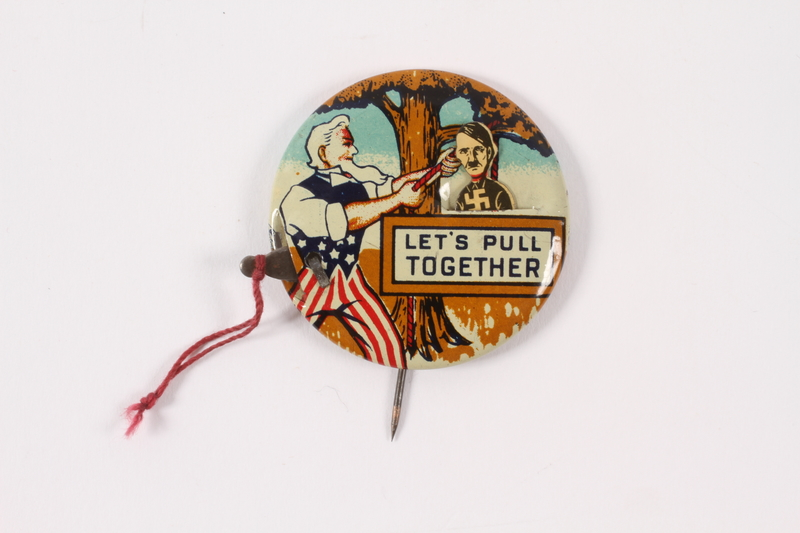 2015.224.9 open Let's Pull Together pin with Uncle Sam hanging Hitler