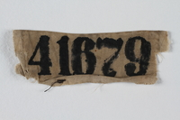 1992.189.3 front Stained white cloth patch with prisoner number 41679 worn in Buchenwald concentration camp  Click to enlarge