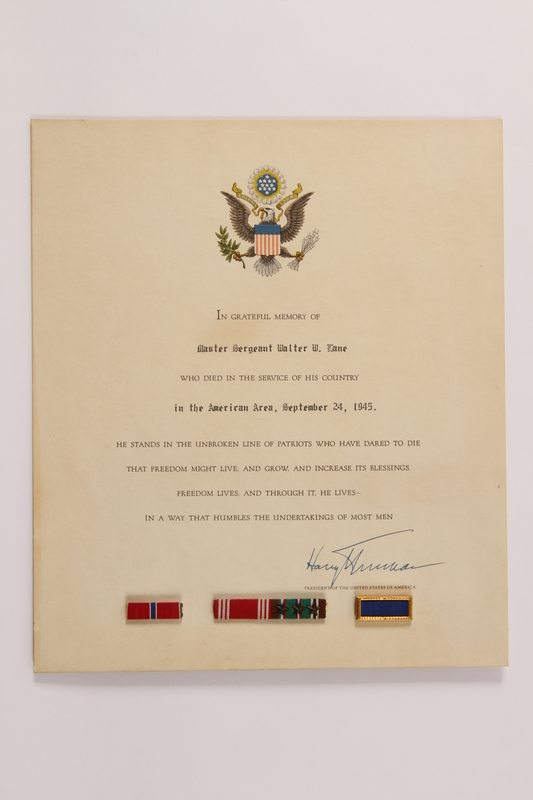 2013.508.3 front Three ribbon bars on a service certificate awarded posthumously for a US soldier